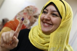 An Egyptian woman shows her inked finger after voting during the second day of presidential elections inside a polling station in the Mataraya neighborhood of Cairo, Egypt, Thursday, May 24, 2012. Egyptians voted Thursday on the second day of a landmark presidential election that will produce a successor to longtime authoritarian ruler Hosni Mubarak. (AP Photo/Fredrik Persson)